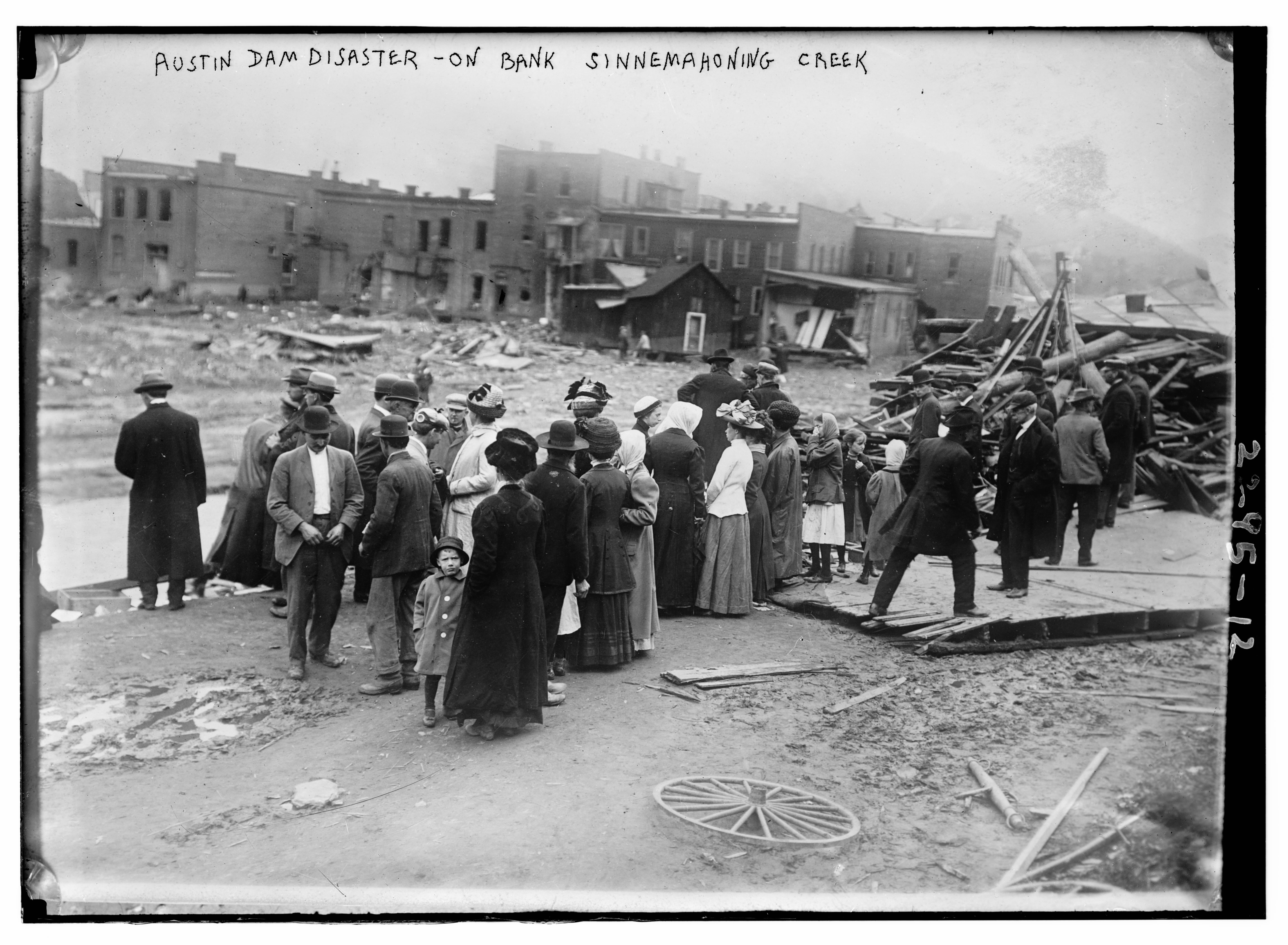 Onlookers survey damage in the aftermath of the Austin Flood