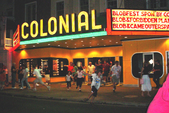 Festival Attendees run out of the Colonial Theatre, re-enacting a scene from The Blob