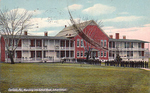 Postcard of Students Marching Into Carlisle Indian School