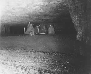 Miners viewing the pillars that support the surface