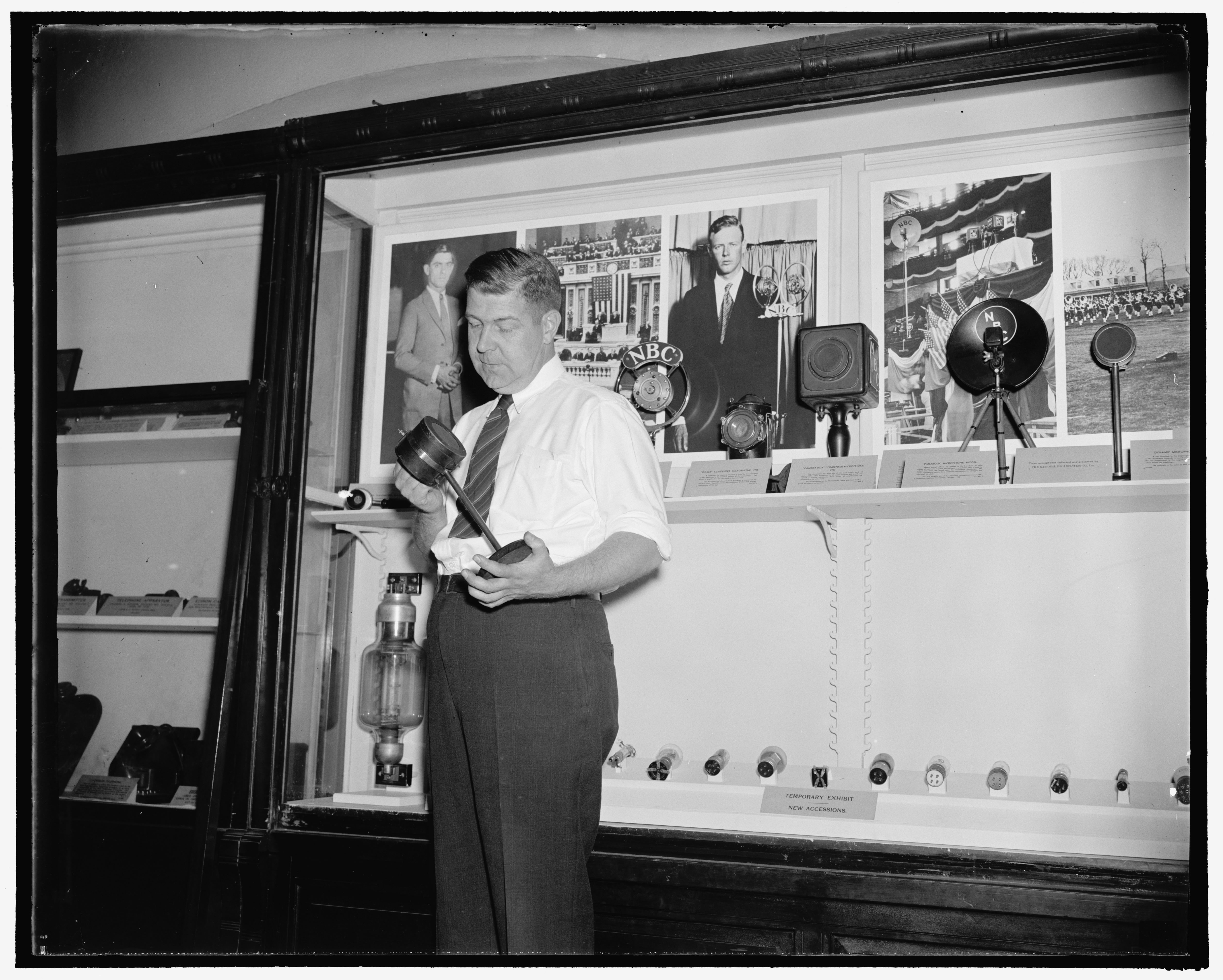 Fred C. Reed holds the tomato can microphone used to announce the returns in the 1920 Presidential election