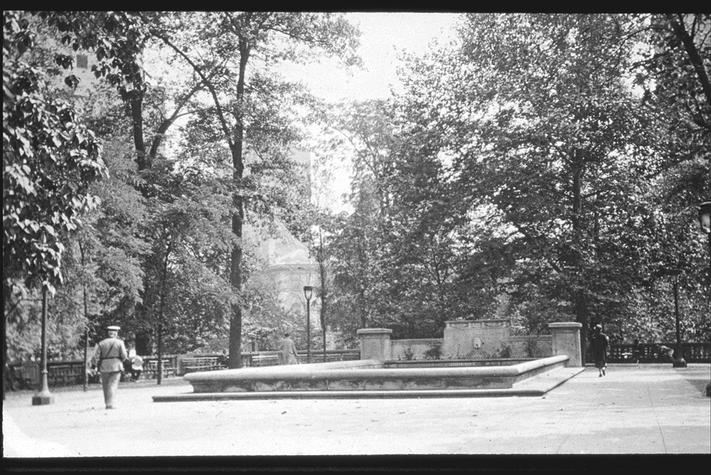 Fountain in Rittenhouse Square with officer on patrol