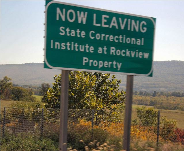 Warning sign on a highway indicating the extent of the Rockview Property