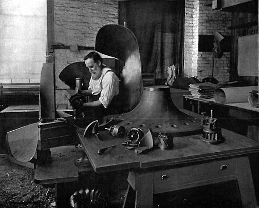John B. McCormick at work in his shop